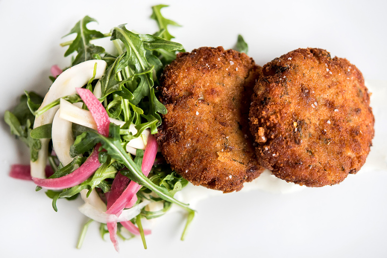 rye crusted salmon cakes with capers, mustard, dill creme friache and mixed greens